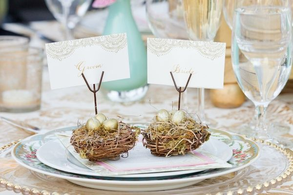 Small nests and golden eggs hold placecards