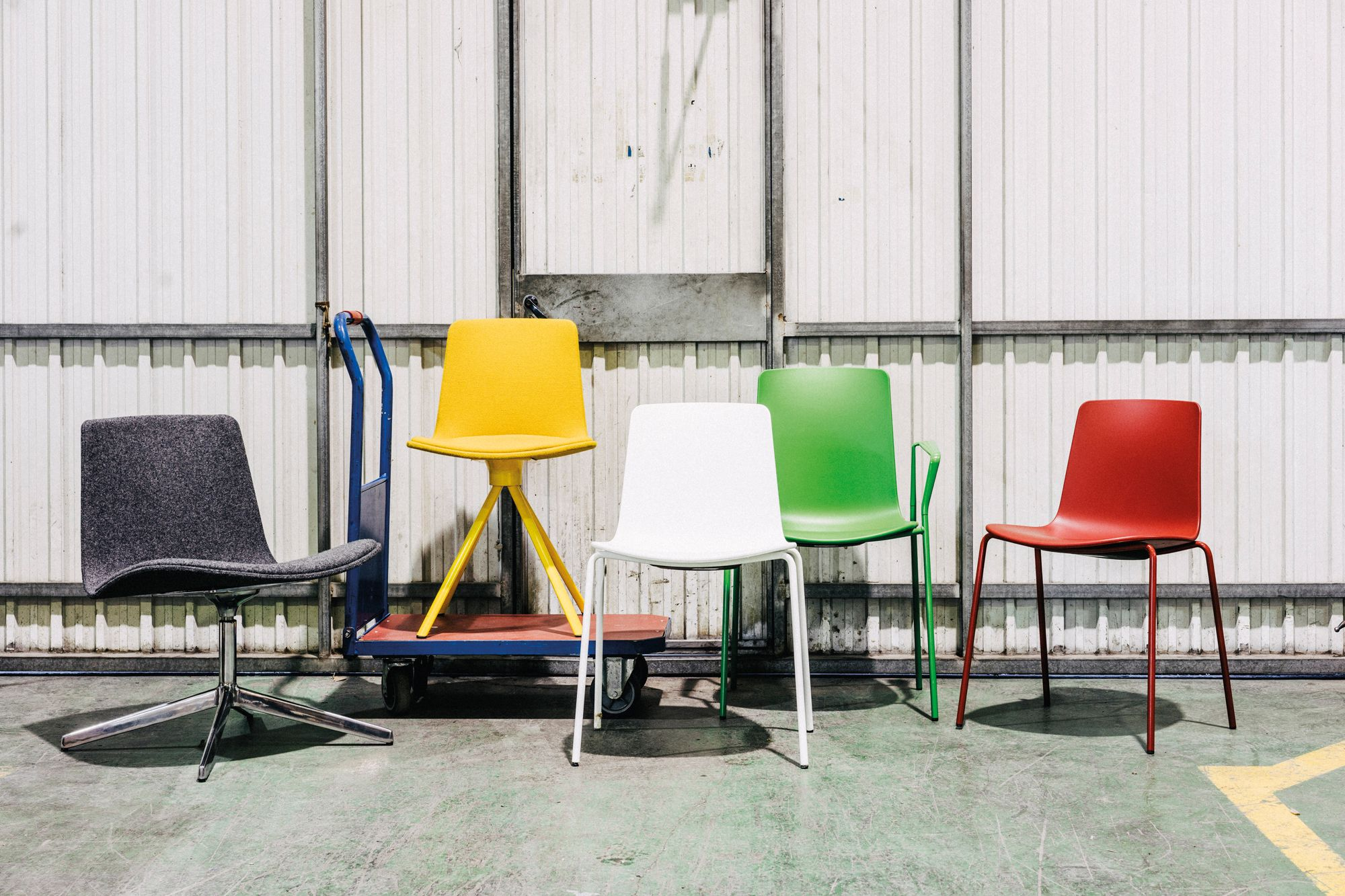 Lottus chairs in red, yellow, green and white and Lottus