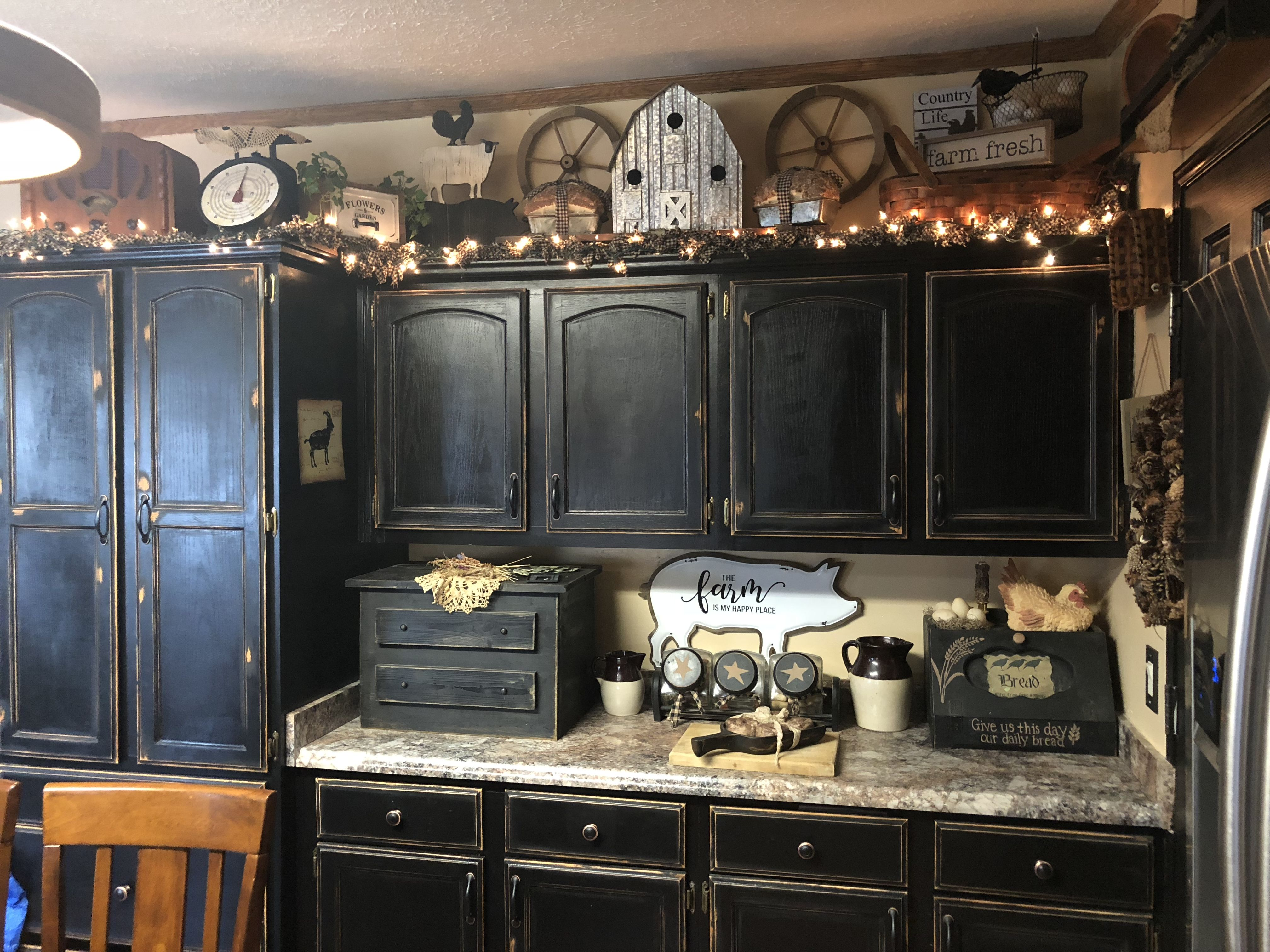 Farmhouse Primitive Decor Above Kitchen Cabinets With Black