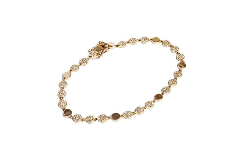 Eternity bracelet set in 14kt yellow gold with pave diamond disks.  294 Dia=0.70 cts
