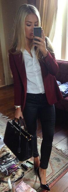 Burgundy blazer, straight blonde hair, open-collared white dress shirt, black skinnies, black stilettos