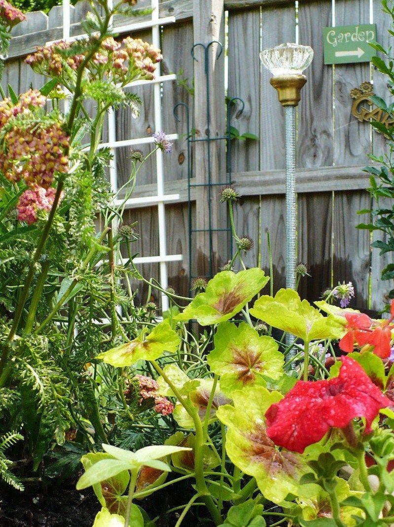 Blinged DIY Garden Hose Guides | Door knobs, Garden ornament and Gardens