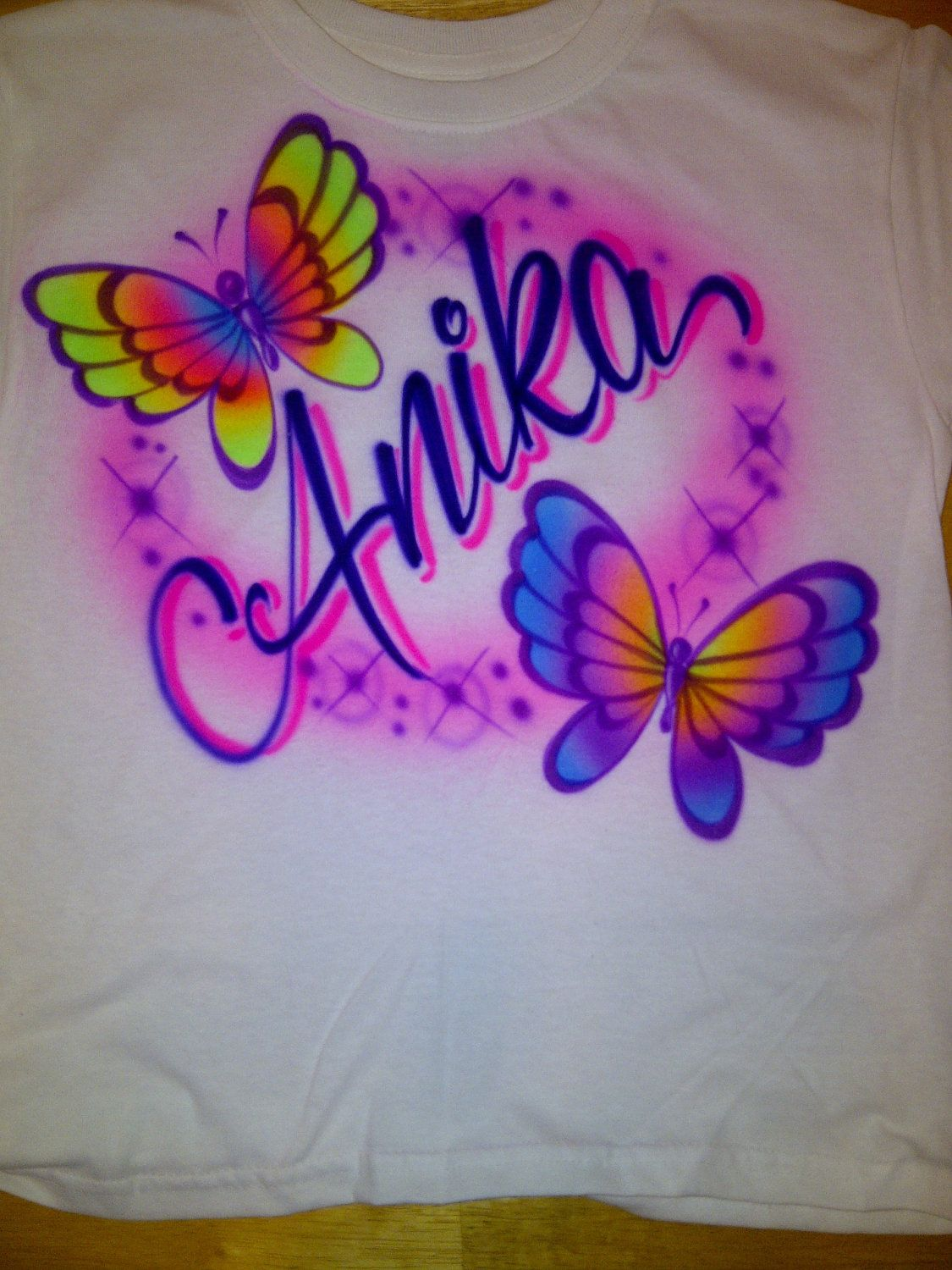 40191ace Airbrushed Personalized Name With Butterflies size S M L XL Y 2-4 6-8 10-12  14-16 Shirt. $14.49, via Etsy.