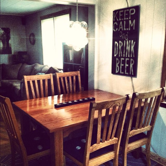 My DIY dining room makeover (homemade chandelier & picture, reupholstered chairs)