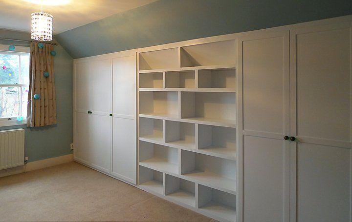 under eaves wardrobe and bookshelf built in bookshelves attic rh pinterest com