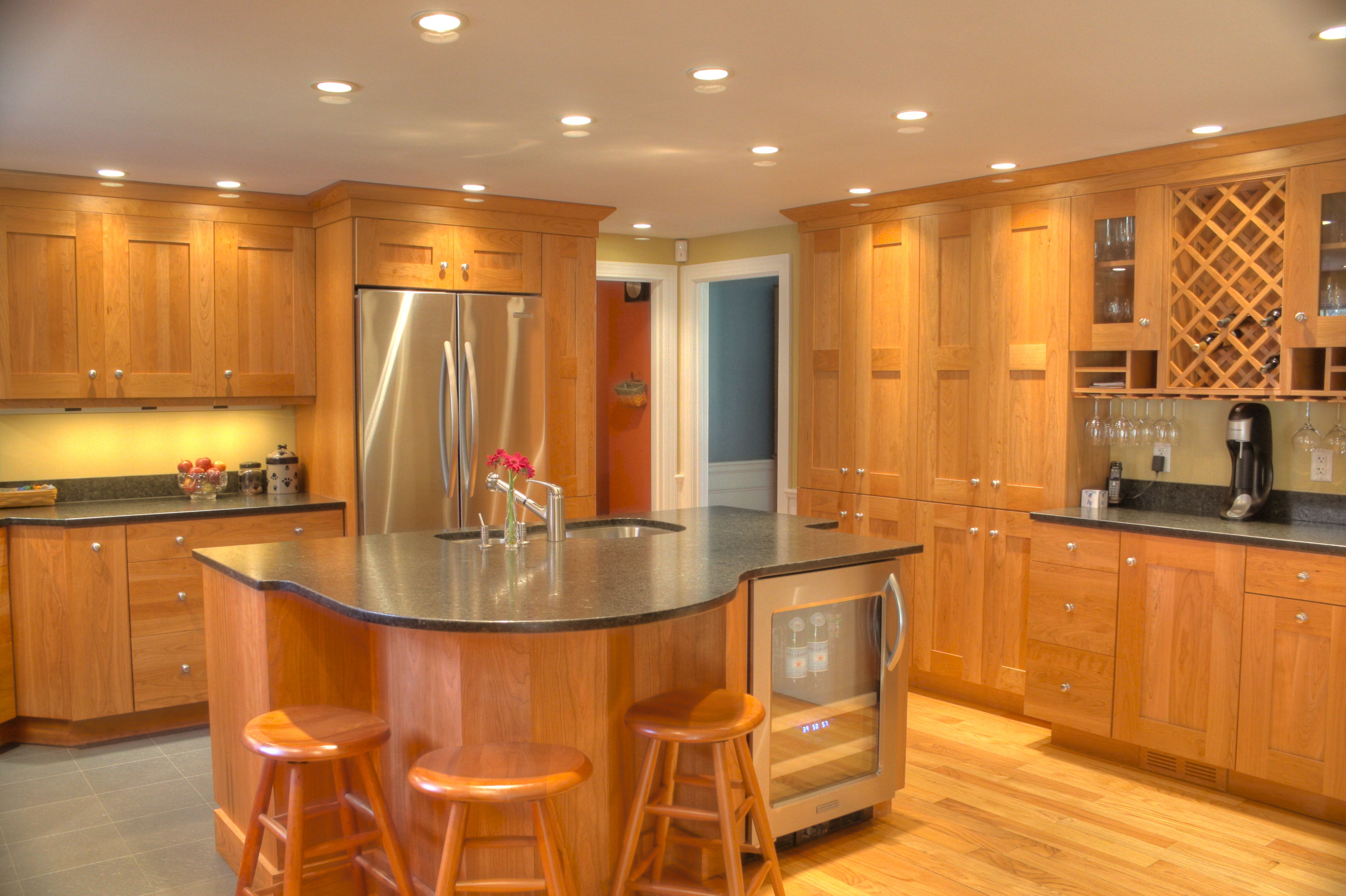 Cherry Wood Kitchens Stainless Steel Appliances Wine Fridge And Wine Storage Island With Sink Kitchen Cabinetry Cherry Cabinets Kitchen Cherry Wood Cabinets
