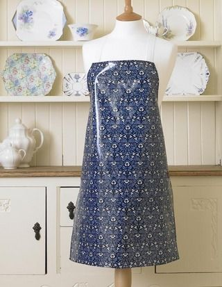 "William Morris Eyebright  floral tablecloth.  This Licensed William Morris Eyebright design was first produced in 1883 at Merton Abbey.  The apron is 29 1/2"" (75 cm) long by 21 1/2"" (54.5 cm) wide with white cotton ties.  The 100% cotton has been coated with a soft feel clear gloss pvc / oilcloth coating.  The cotton was printed, pvc coated and the tablecloth manufactured in the UK.  The apron is wipe clean."
