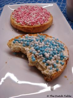 "Dutch tradition: ""BESCHUIT MET MUISJES: serving 'beschuit met muisjes' (Dutch biscuit with little aniseed balls) to celebrate the birth of a baby. Rose for a girl, blue for a boy."""