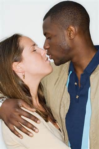 Black and white guys kissing