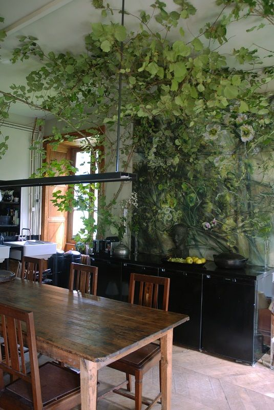 Plant art & reality merge at the home of Claire Basler. In a similar vein, imagine growing ivy along the wooden posts and beams of an indoor wall and ceiling....