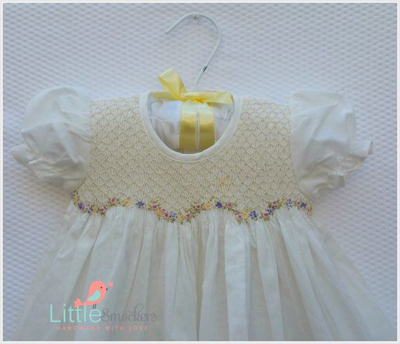 this one off little baby dress is made with a gorgeous 100 cotton fabric with a elegant hand smocked bodice and hand embroidered little rosettes across the