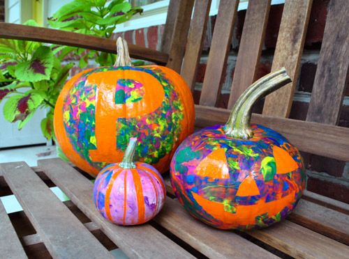 Cute way for little kids to decorate pumpkins.  Put tape on pumpkin in any design you want and let kids paint around them.  Then peel off tape!