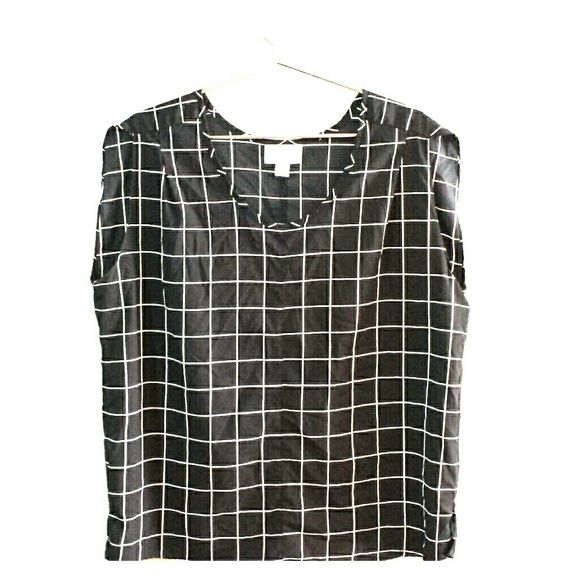 Target black and white grid print sleeveless top Great condition, no snags holes or stains. Only worn a handful of times. Great to wear under a blazer for work. Pure Energy Tops Blouses