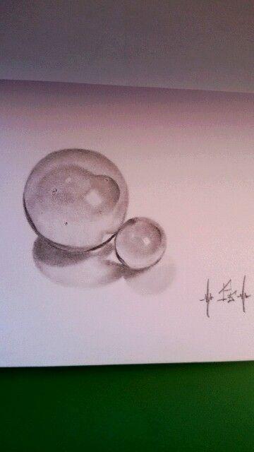 Biglie di vetro, disegno a matita.