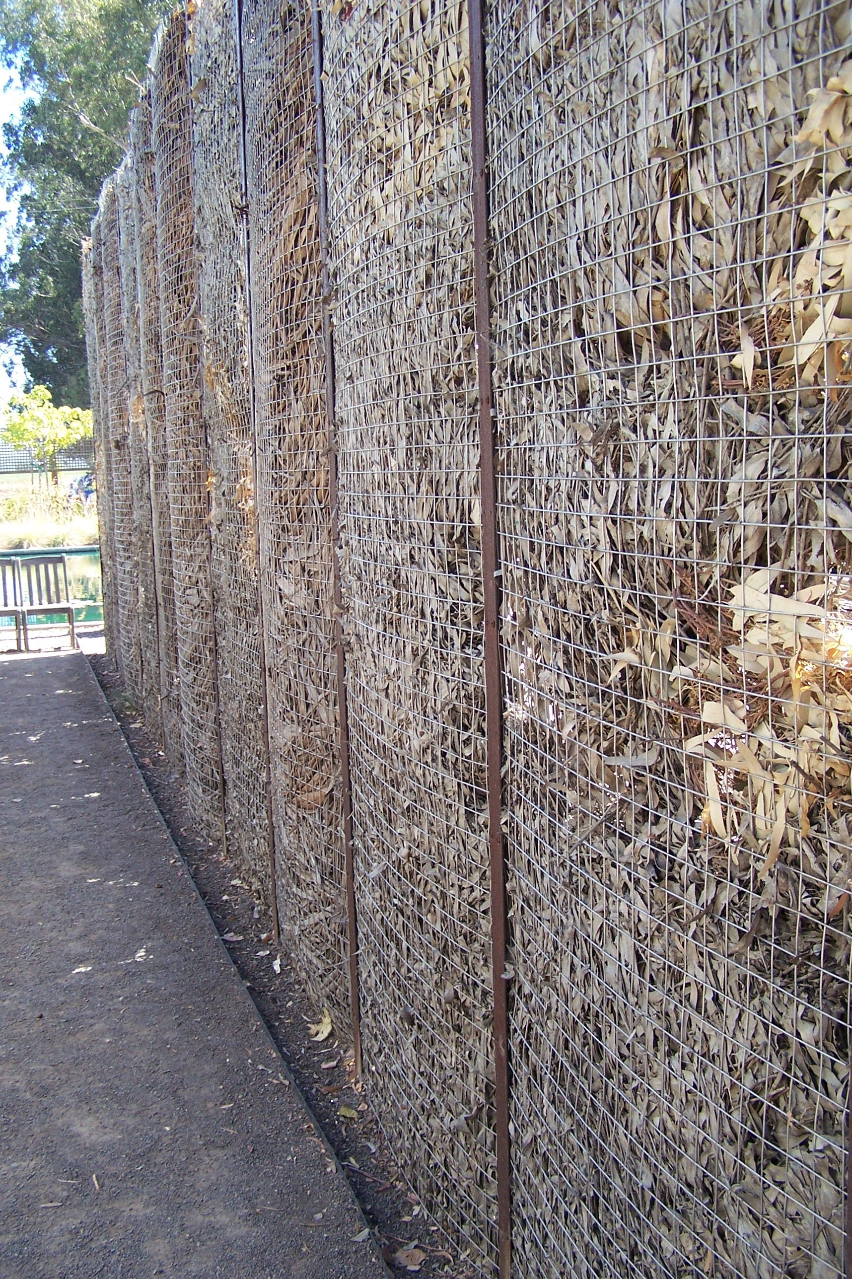 Like this fence made from metal stakes, 2 layers of wire mesh and ...