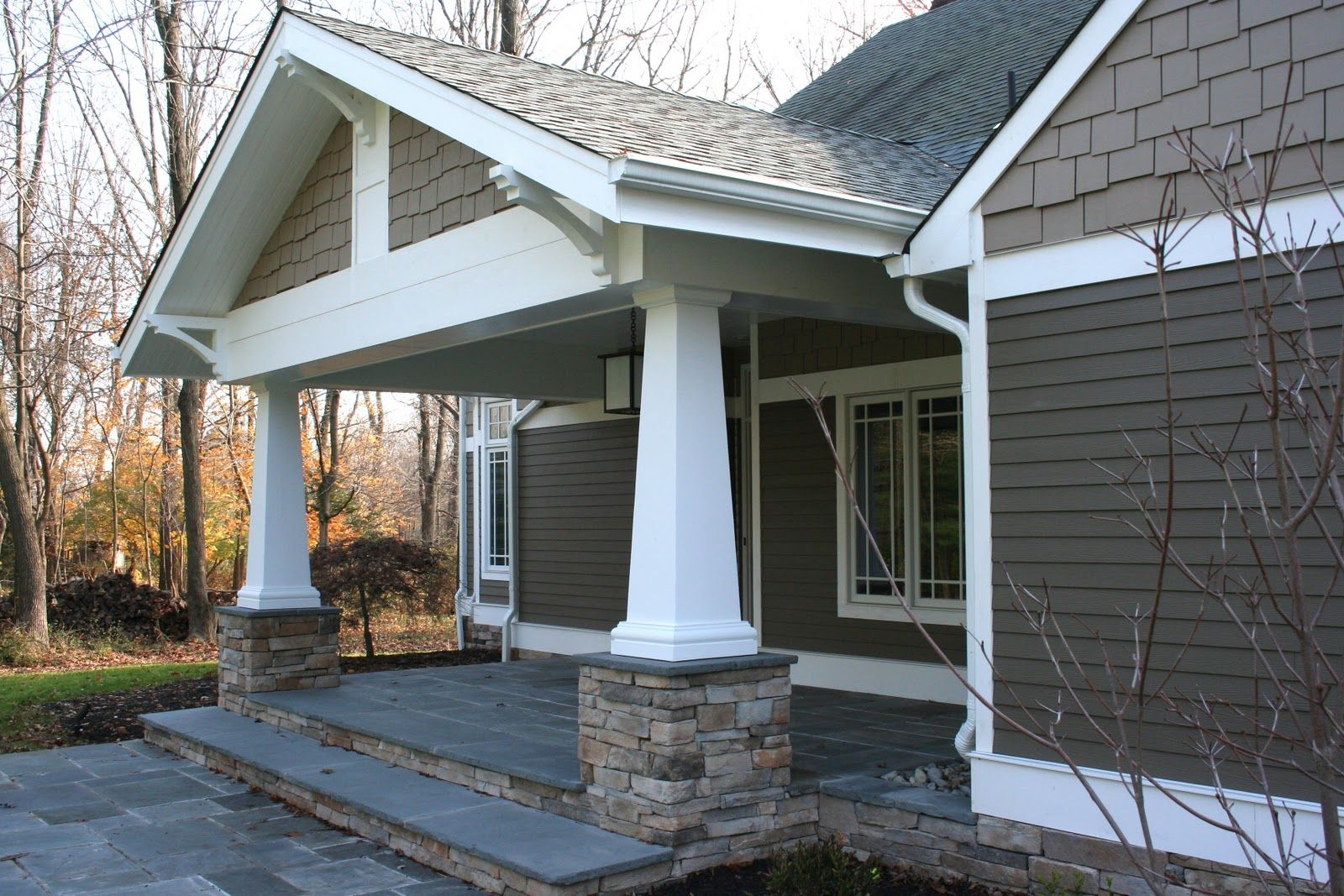 The Porch Is The Most Dramatic With Tapered Craftsman Columns Stone Piers An