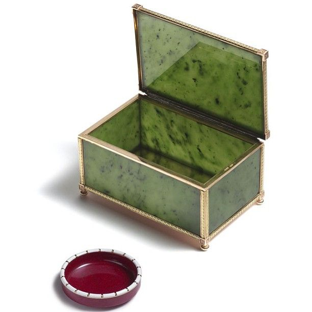 A Stunning Siberian Nephrite Casket by Carl Faberge, an Imperial acquisition bought by Tsar Nicholas II and Tsarina Alexandra Feodorovna. Nephrite was highly prized by the Russians and could only be worked by lapidaries with special permission from the Hermitage Palace. It is accompanied by a purpurine dish also by Faberge.