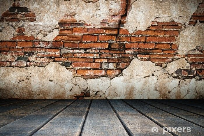 Wall Mural Cracked plaster of old brick wall