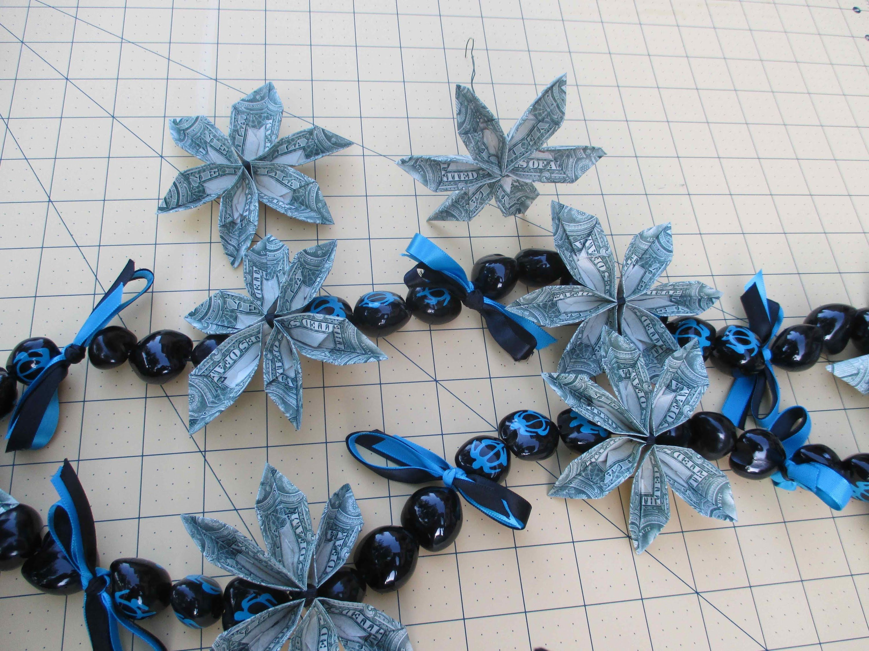 How To Make A Origami Money Flower And Kukui Nuts Lei