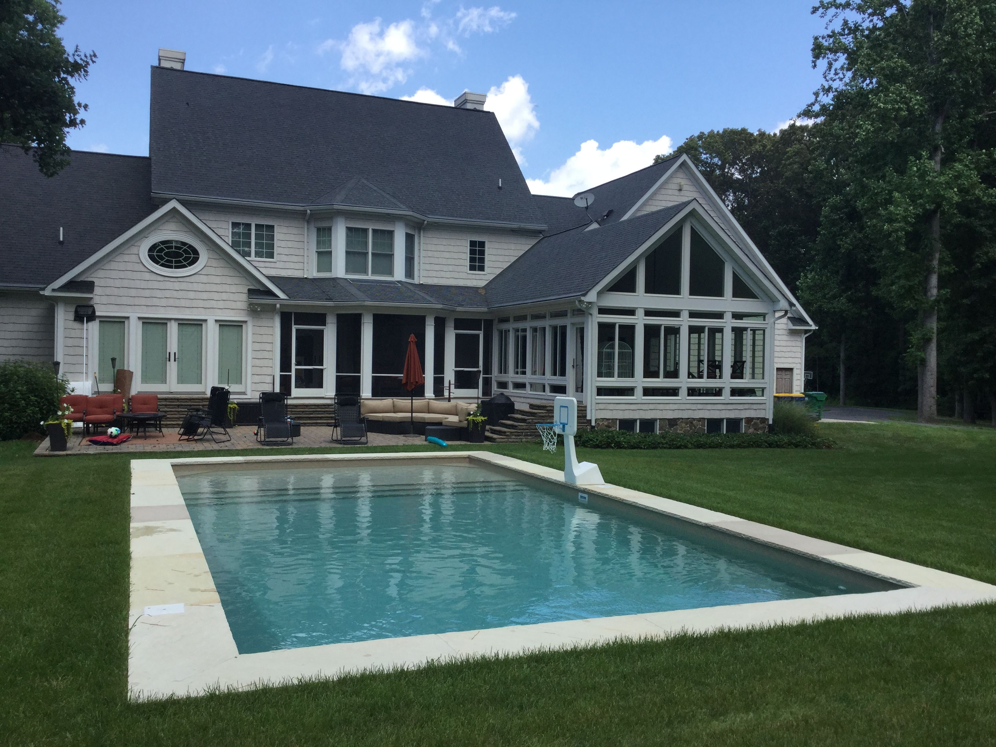 Radiant Rectangle Inground Pool With Inside Steps And Lounge Area