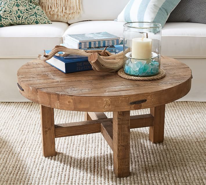 Marietta Round Coffee Table Solid reclaimed wood gives the