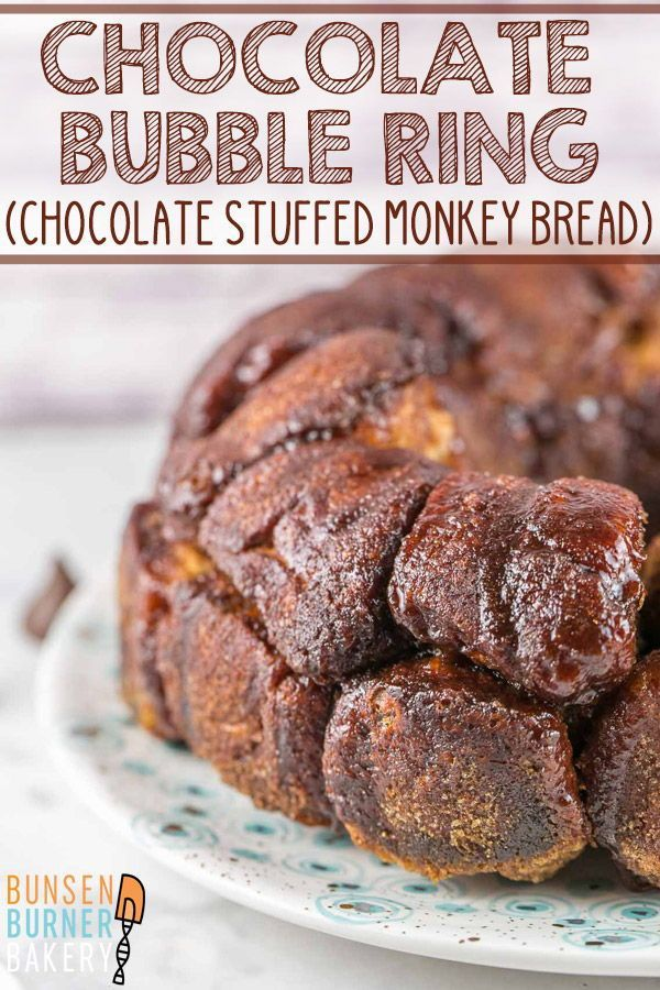 Chocolate Bubble Ring #monkeybreadwithcannedbiscuits Chocolate Bubble Ring Recipe: Hershey kiss stuffed biscuits rolled in cinnamon sugar -- it's like a chocolate stuffed monkey bread! An easy recipe with canned biscuits, this pull apart bread is the perfect dessert for breakfast! #bunsenburnerbakery #bubblering #monkeybread #chocolate
