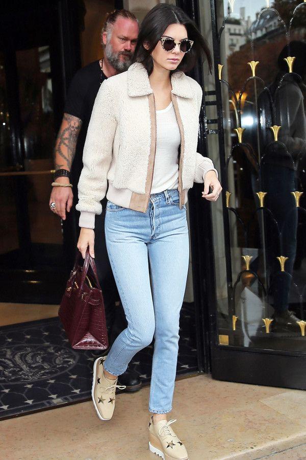Kendall Jenner in light wash denim, platform oxfords, and a sherpa jacket.