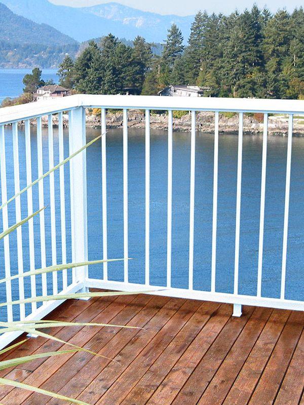 Wonderful View Of The Clear Blue Ocean From This White Balcony Railing Balcony Railing Aluminum Railing Railing