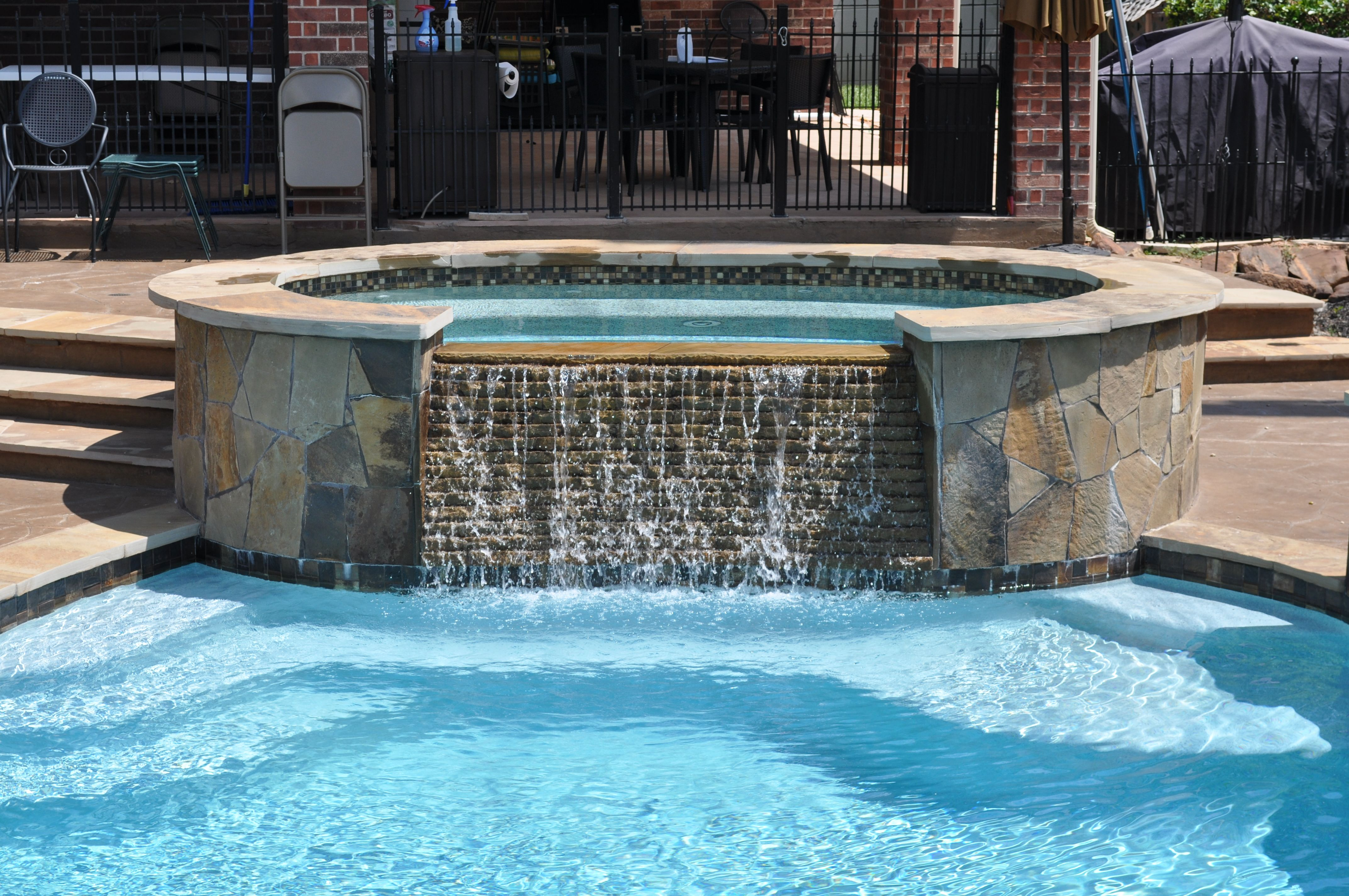 Pool And Spa With Step Down Deck Area In Stamped Overlay Concrete With Flagstone Steps Coping And Facing The Raised Pool Pool Coping Inground Pool Pricing