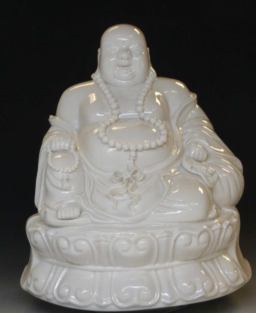 Porcelain happy buddha statue on beautifully detailed lotus base porcelain happy buddha statue on beautifully detailed lotus base symbolic of contentment and good fortune biocorpaavc Choice Image