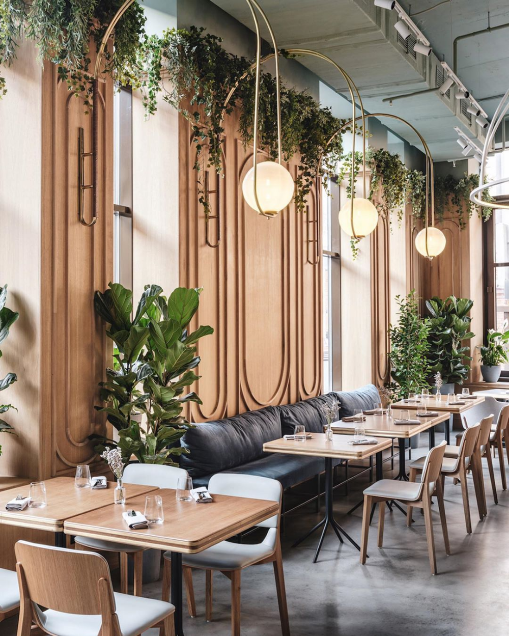 Wood Walls With Circular Trim Lots Of Plants Big Bulb Lighting In 2020 Restaurant Interior Design Restaurant Interior Cafe Interior Design