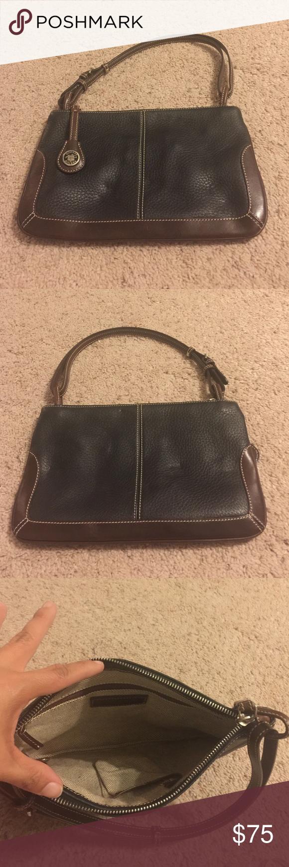 Dooney & Bourke Purse Dooney & Bourke Shoulder Bag. Used a few times. Adjustable straps. Dooney & Bourke Bags Shoulder Bags