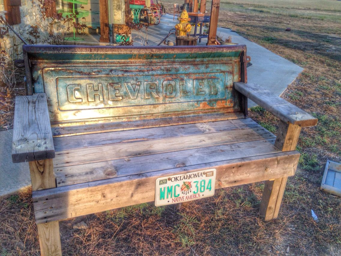 A tailgate bench by Teal Death Do Us Part. This vintage tailgate features a fabulous original patina and is made with recycled wood. See more at www.facebook.com/tealdeathdouspart