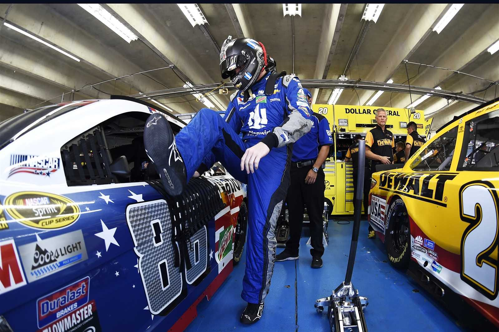 At-track photos: Saturday, Charlotte:    Saturday, May 28, 2016  -   CHARLOTTE, NC - MAY 28: Dale Earnhardt Jr., driver of the No. 88 Nationwide Chevrolet, steps into his car during practice for the NASCAR Sprint Cup Series Coca-Cola 600 at Charlotte Motor Speedway on May 28, 2016 in Charlotte, North Carolina.