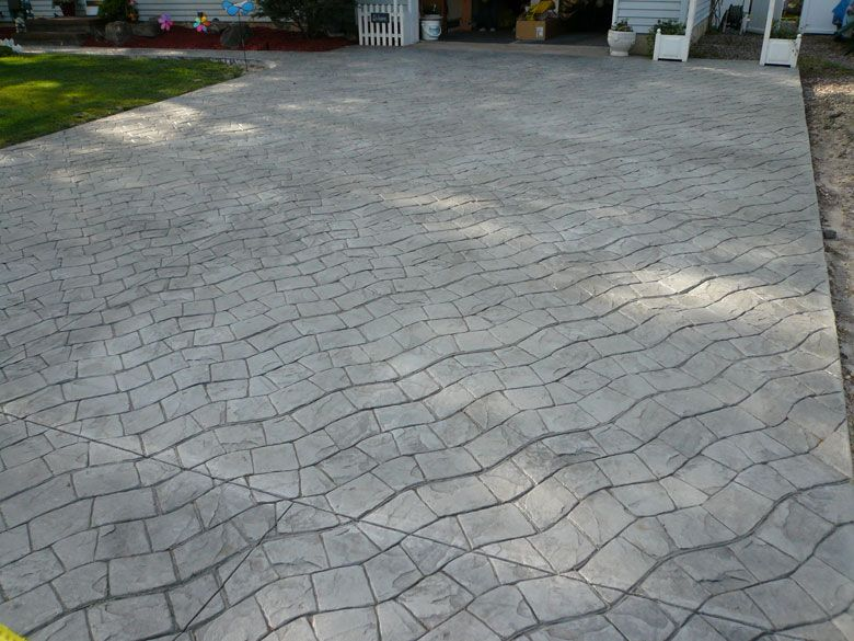 Gray Driveway With Serpentine Cobblestone Stamp