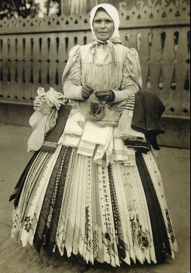 Russian Handkerchief Seller 1890s.  And I also absolutely love that beautiful picket fence behind her :)