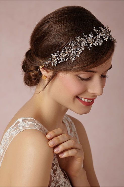Swarovski crystals, freshwater pearls, and glass beads nestle together to create a whimsical muse-like wreath of baby's breath flowers. BHLDN, Spring 2014