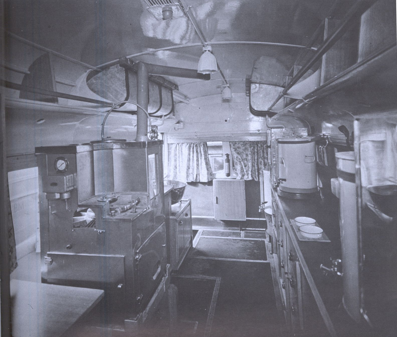 The inside of a London bus converted into a clubmobile for serving coffee and doughnuts.