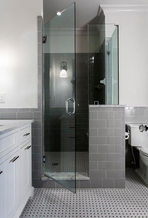 Contemporary Bathroom Features A Seamless Glass Shower With Corner