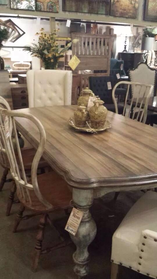 Antiqued farm table with wooden side chairs and upholstered end chairs