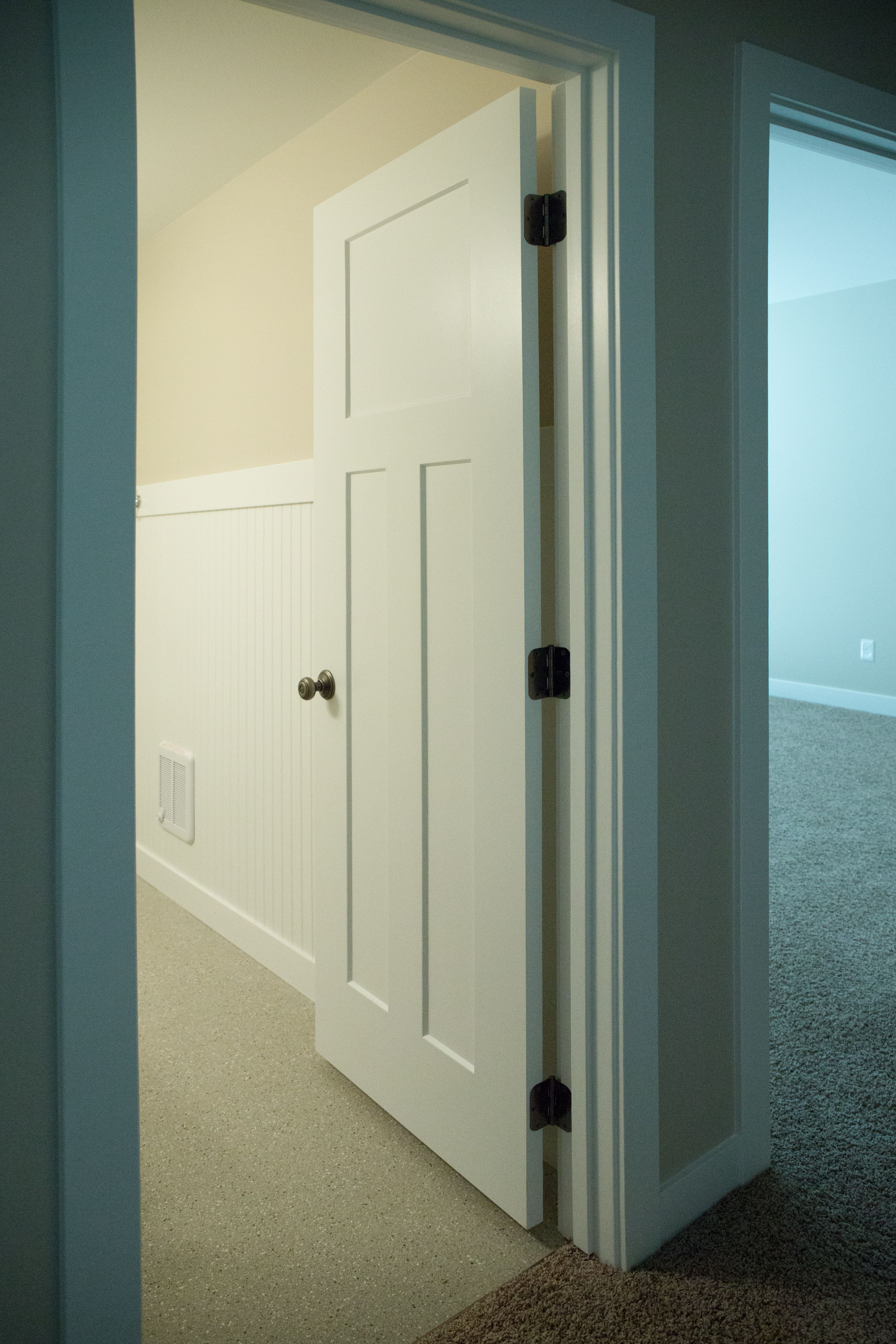 Interior doors a crisp painted white three panel interior door interior doors a crisp painted white three panel interior door with contrasting planetlyrics Gallery