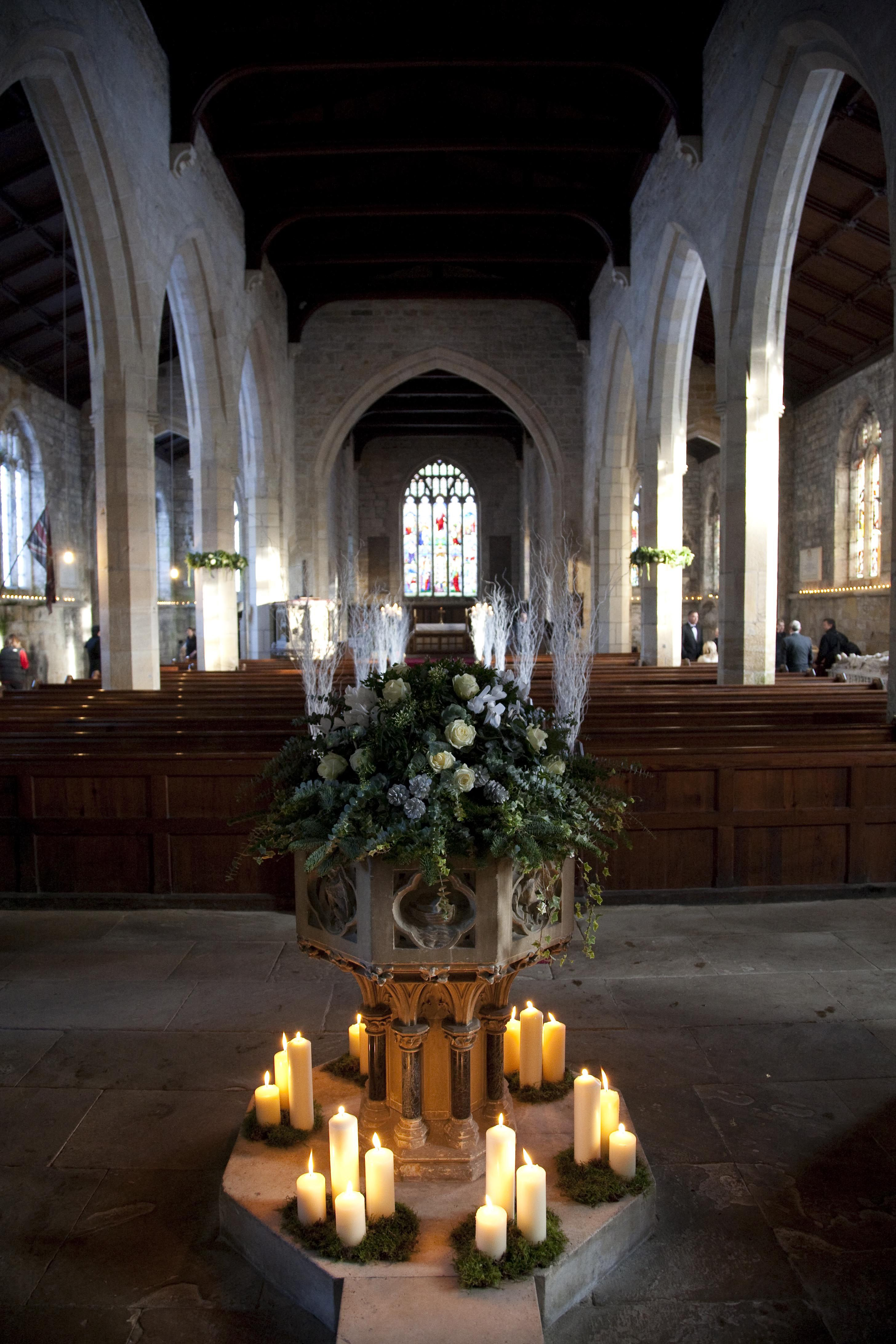 church wedding decorations candles%0A Traditional church styling  candles around the font with green floral