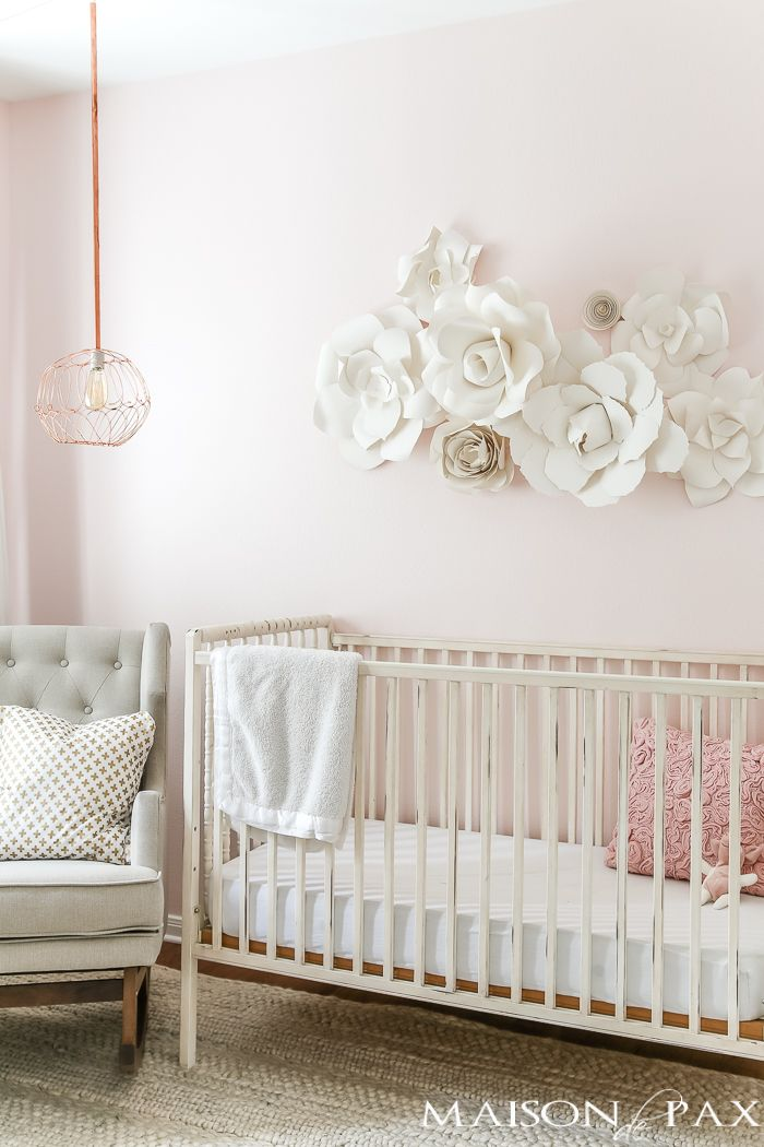 Paper flowers as wall decor in  nursery what gorgeous soft feminine space almost all neutral very pale blush on the walls and natural also flower art crib rh pinterest