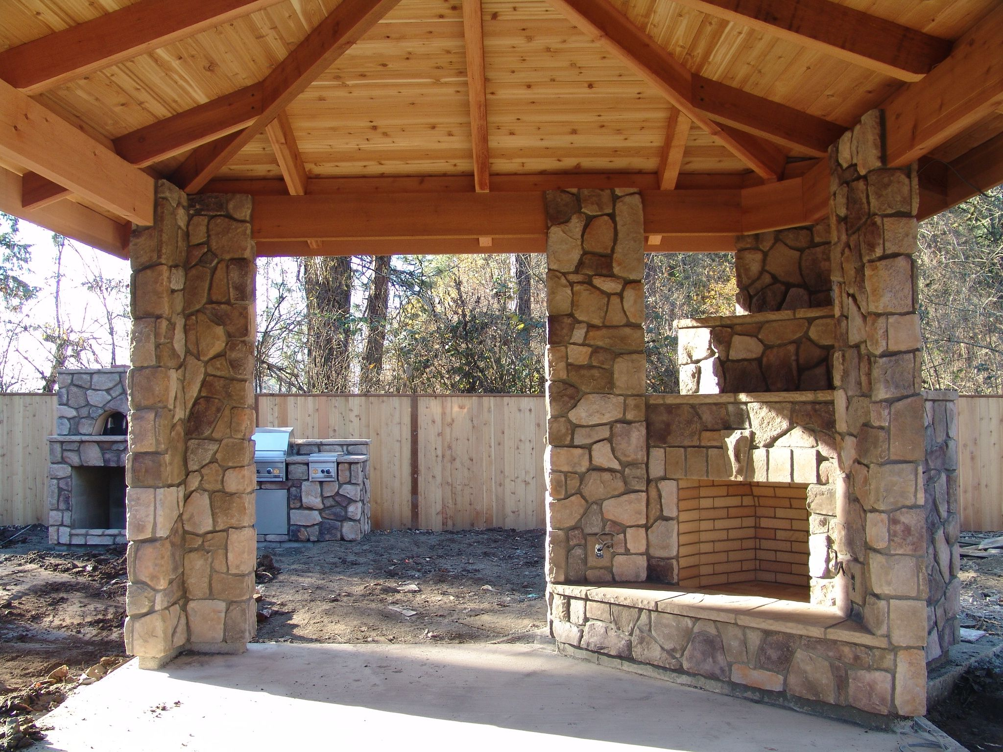 outdoor kitchen with fireplace area rug and corner