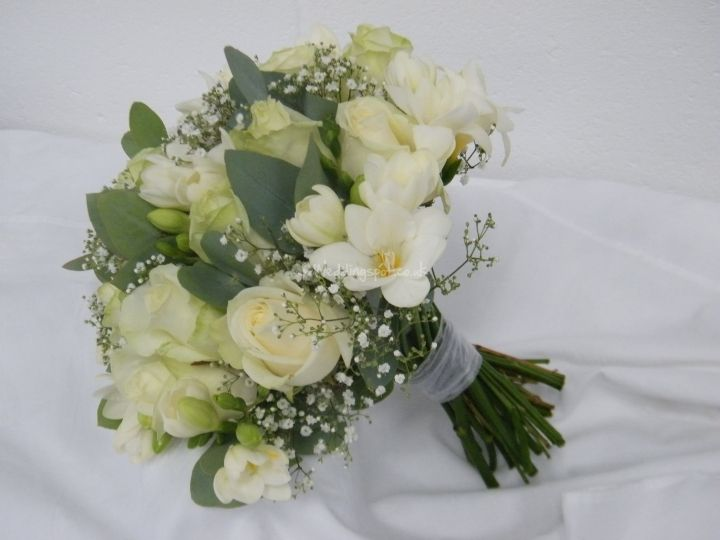 Bride S Tied Bouquet Of Avalanche Roses White Freesia Gypsophila