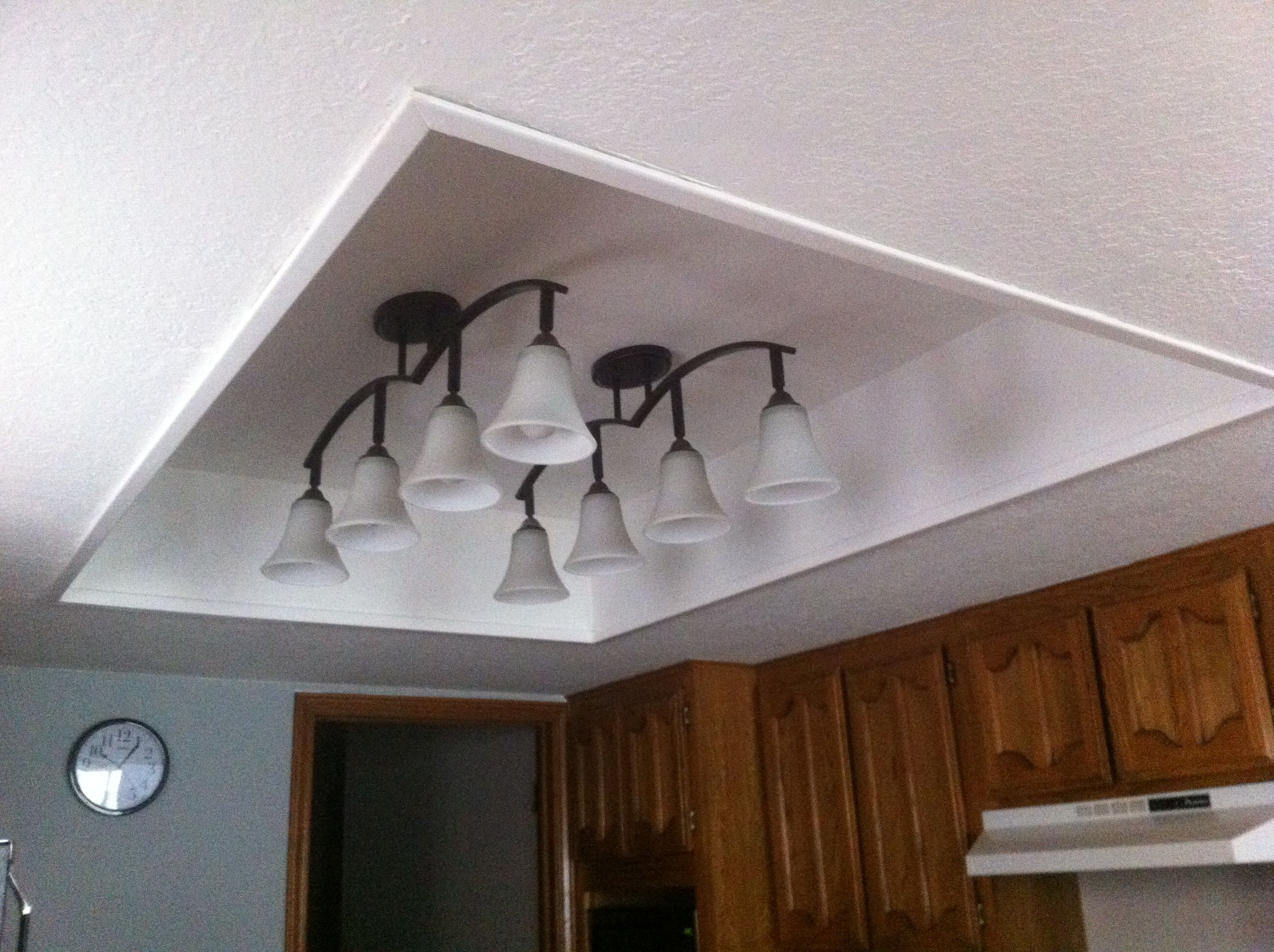 kitchen fluorescent light tall wall cabinets remove old framed panel with lights finish off box add new fixtures