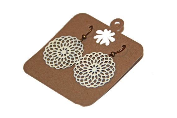 Round Filigree / Lace Earring, ~1 inch diameter. $8 on etsy from WhiteBlossom13.