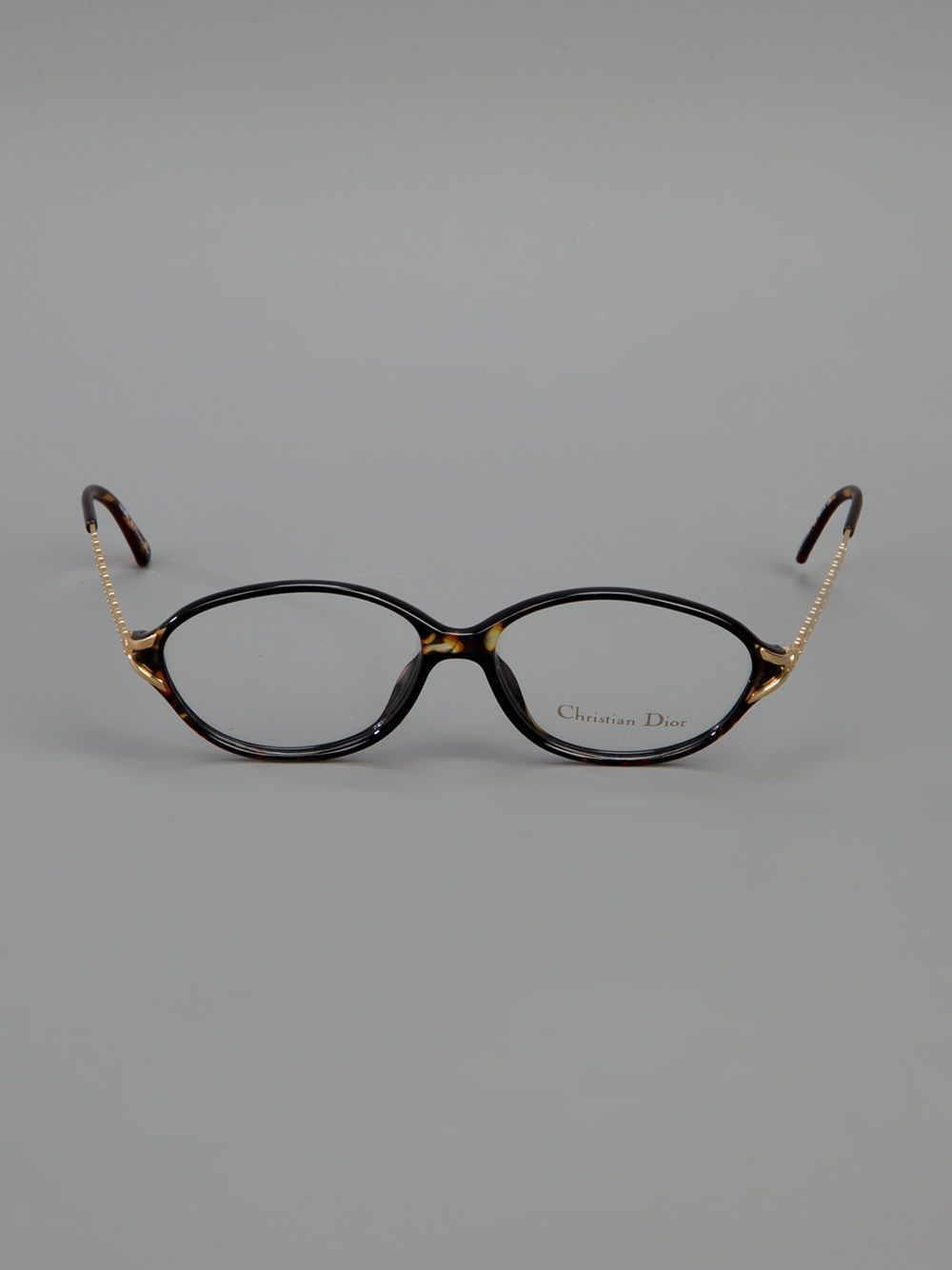 6818b529785 Black celluloid glasses from Christian Dior Vintage featuring round frames  and gold-tone metal arms