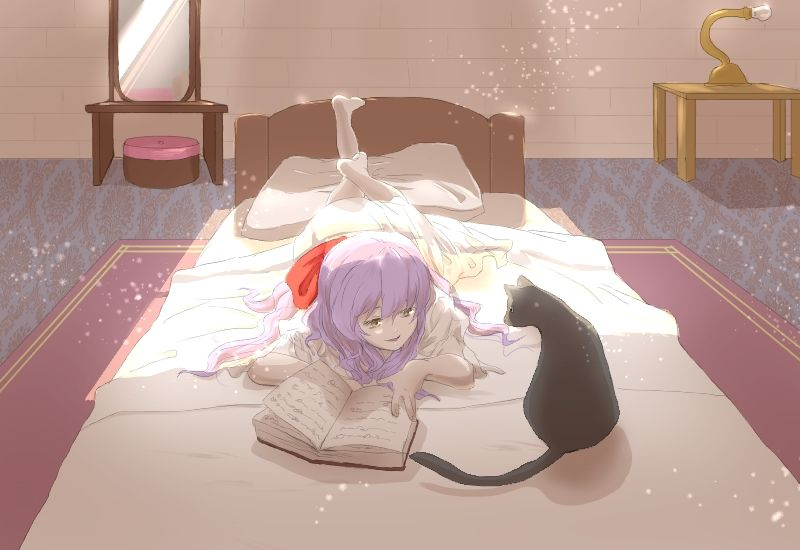 Ellen on her bed with the cat - The Witch's House
