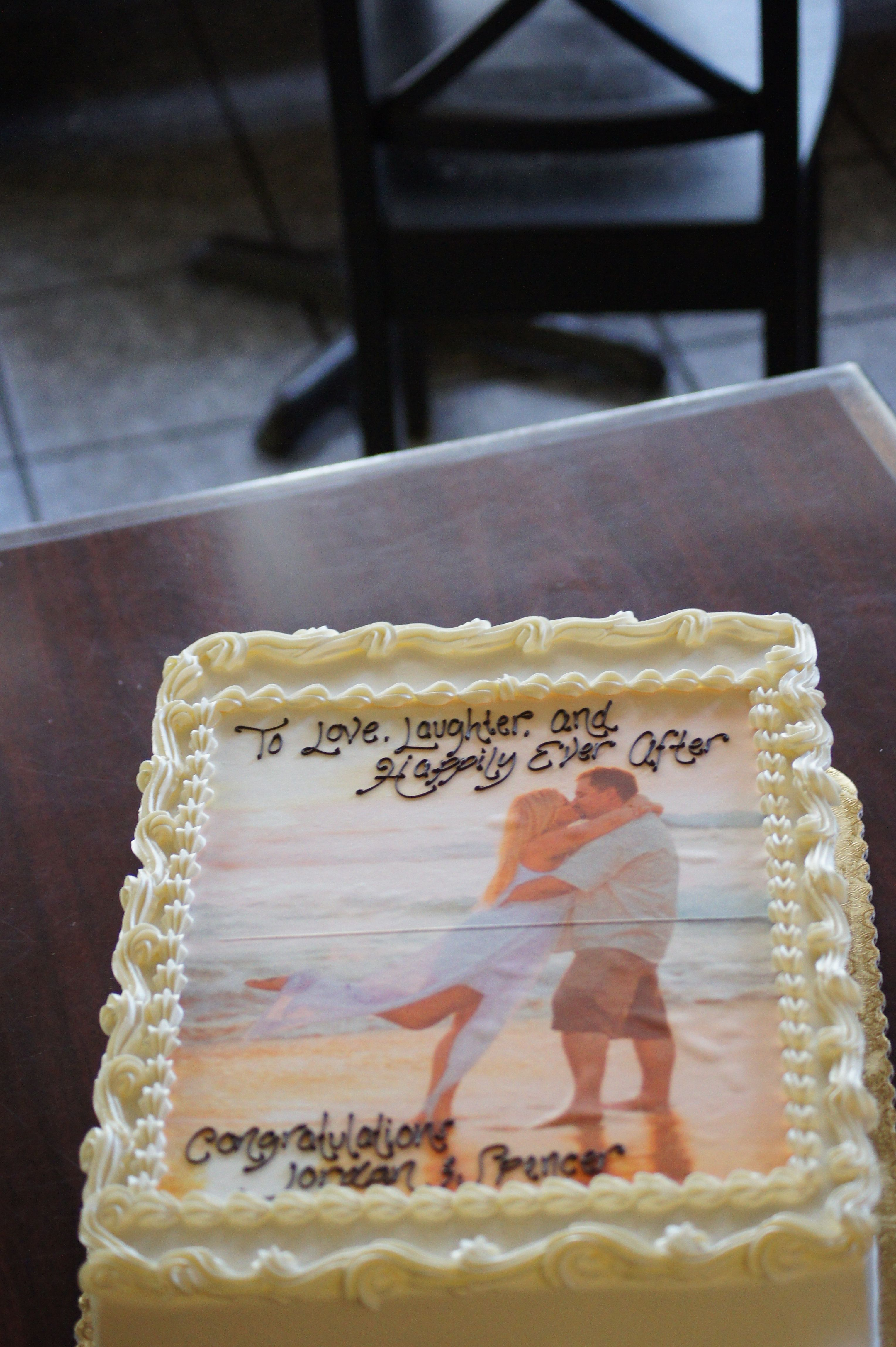 White engagement party sheet cake with edible image